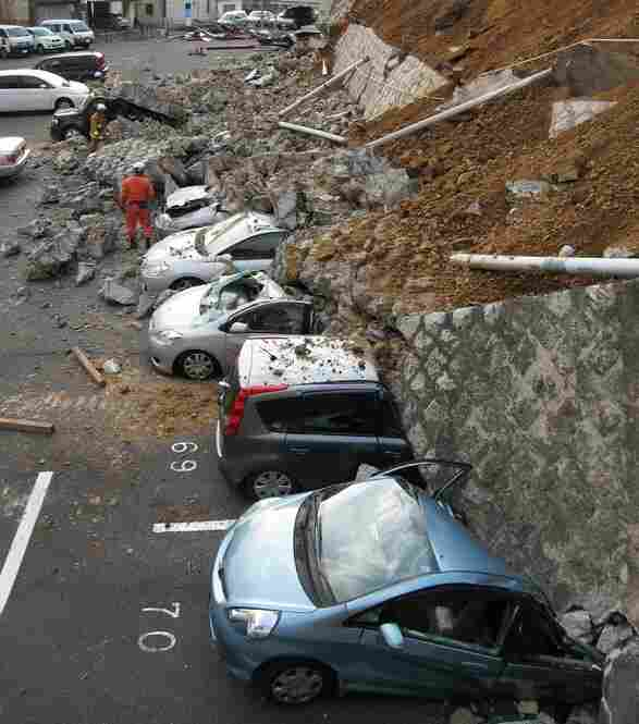 A collapsed wall crushed vehicles at a parking lot in Mito city, about 80 miles north of Tokyo.