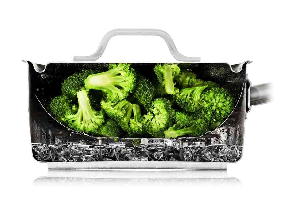 The cutaway photos — like this one of broccoli steaming — are all real. The Modernist Cuisine team arranged food in the cut-in-half equipment and then took photos.  In most cases, the food is really being cooked as shown.