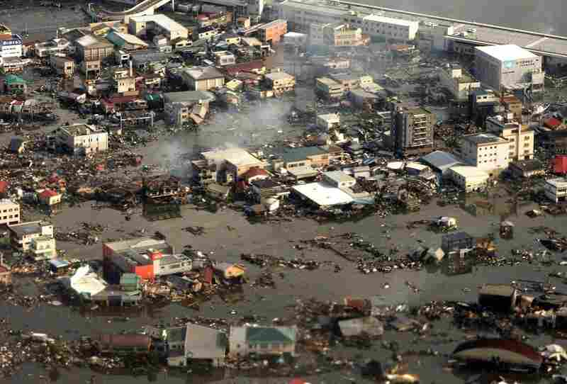 An aerial view of the devastated city of Kesennuma in Japan's Miyagi prefecture on Saturday. A tsunami unleashed by a massive quake wreaked destruction across northeast Japan.
