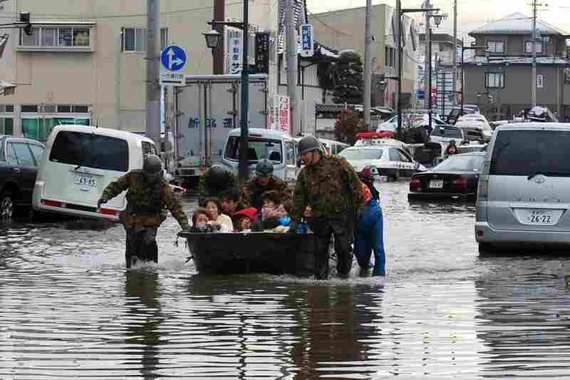 Soldiers evacuate residents of Tagajo in northern Japan.