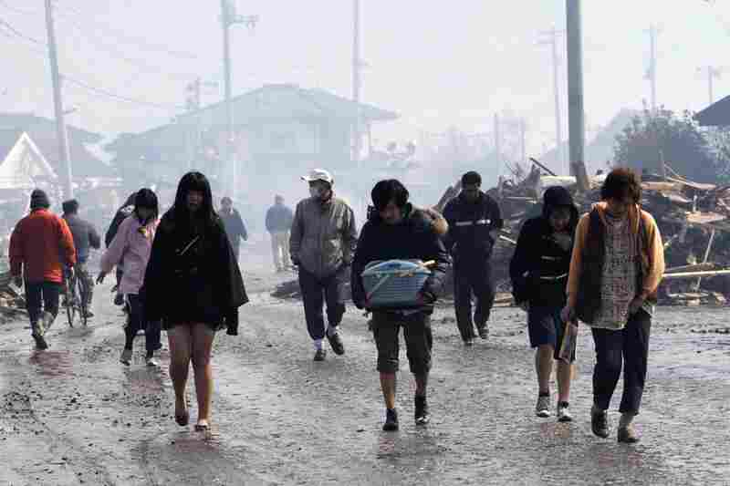 Natori city in northeast Japan is evacuated Saturday. More than 1,000 people are feared dead.