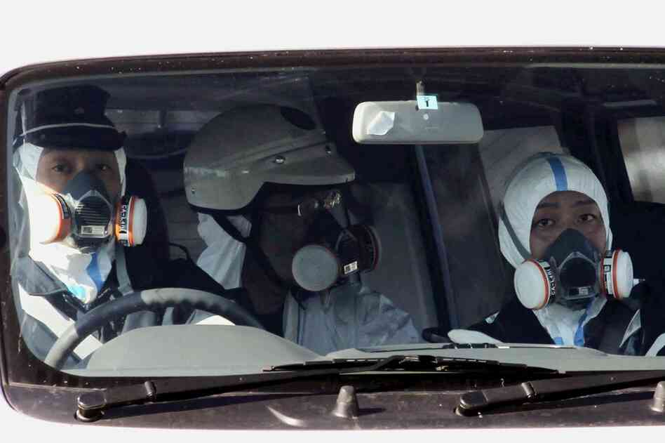 Police officers patrol near the nuclear power plant in Fukushima on Saturday.