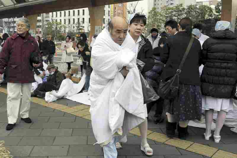 A hospital in Sendai, Miyagi prefecture, is evacuated following the magnitude 8.9 earthquake and tsunami that hit Japan on Friday.