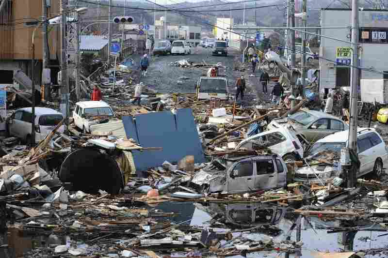 Vehicles and rubble cover a road in the city of Kesennuma in northern Japan.