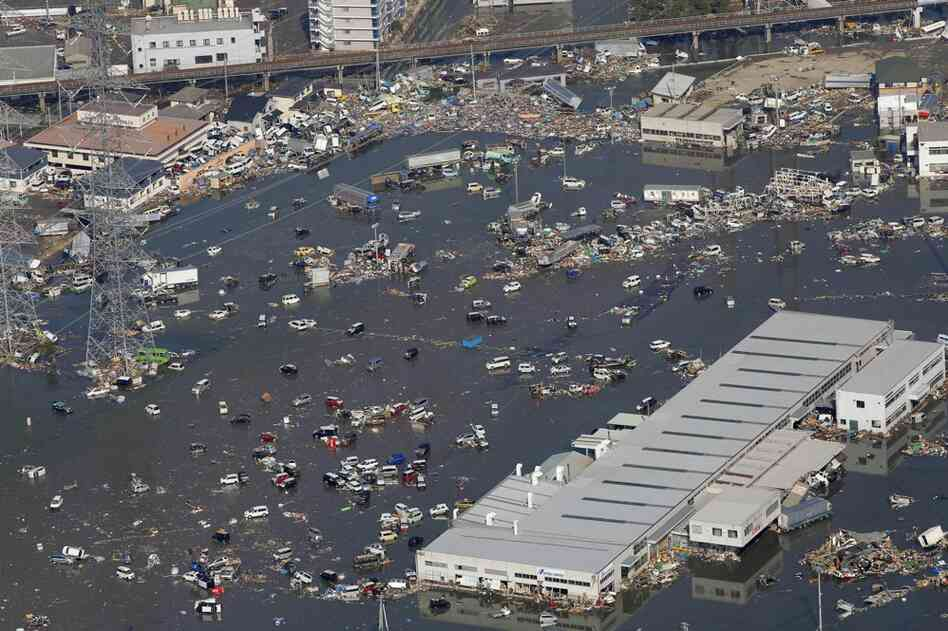 Areas of Sendai, the biggest city near the quake's epicenter, remain flooded.