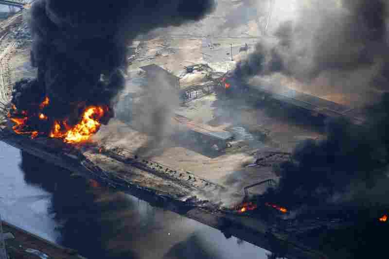 An industrial area burns in Sendai.