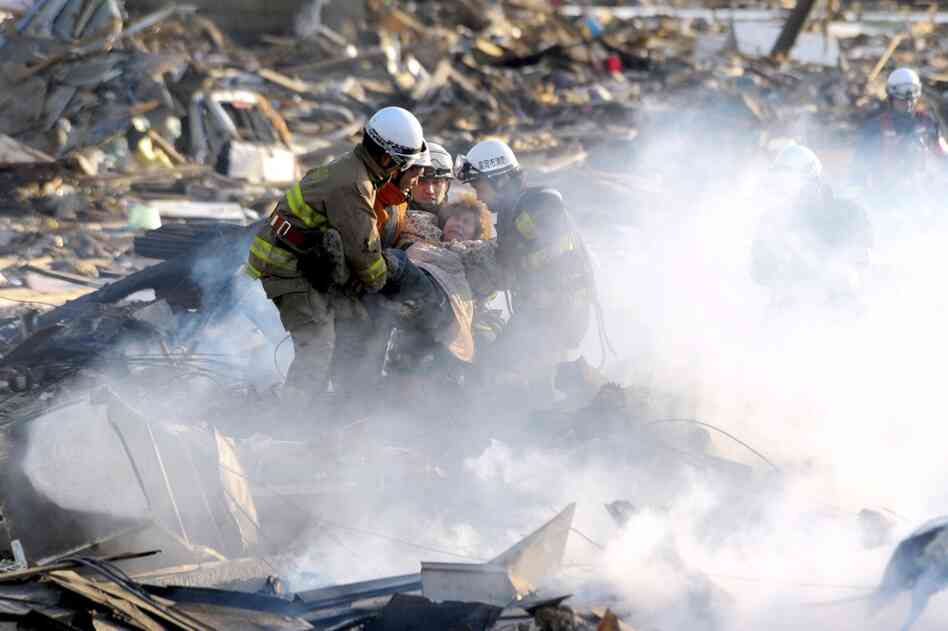 A resident is rescued from debris in Natori, northeast Japan.