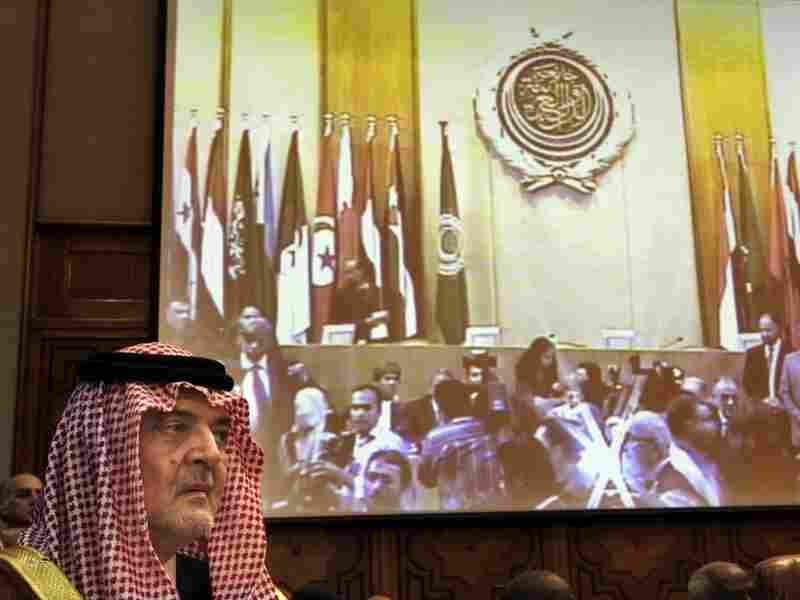 Saudi Arabian Foreign Minister Saud al-Faisal looks on under a screen displaying the Arab League's emergency meeting Saturday in Cairo.