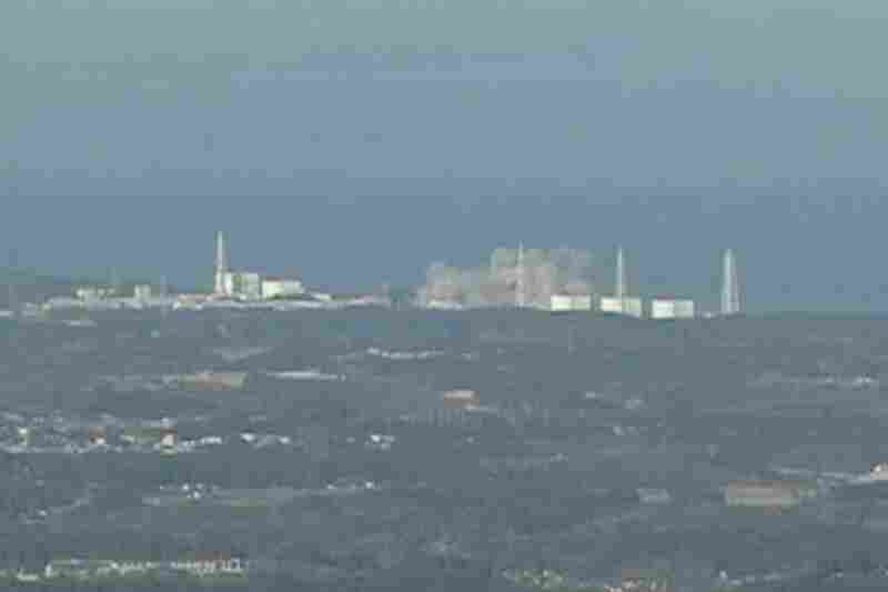 Smoke rises from the Fukushima nuclear power plant following an explosion that spewed large amounts of radiation.