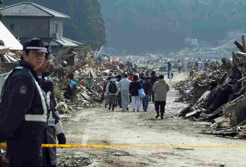 Residents return to a restricted area to look at their quake-damaged homes in Miyagi prefecture on Sunday.