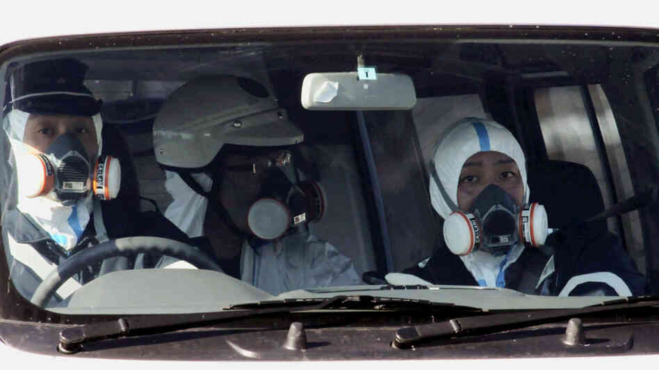 Police officers wore gas masks as they patrolled near the nuclear power plant in Fukushima prefecture today (March 12, 2011).