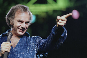 "Diamond continued to churn out present-day classics like ""Holly Holy"" and ""Song Sung Blue,"" which reached No.1 on the Hot 100. After performing in sold-out venues, Diamond released Hot August Night in 1972, an album critics hail as ""the ultimate Neil Diamond record."" Here, Diamond performs at New York's Madison Square Garden in 1986."