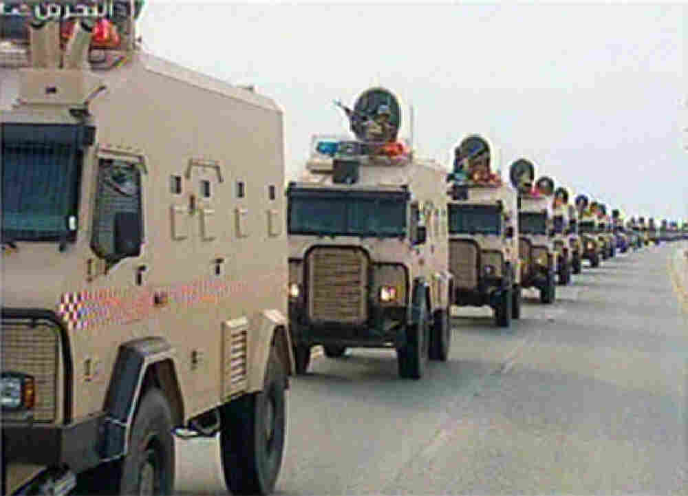 """An image grab taken from Bahrain TV shows """"vanguard"""" of a contingent of Gulf troops arriving in the unrest-wracked Kingdom of Bahrain."""
