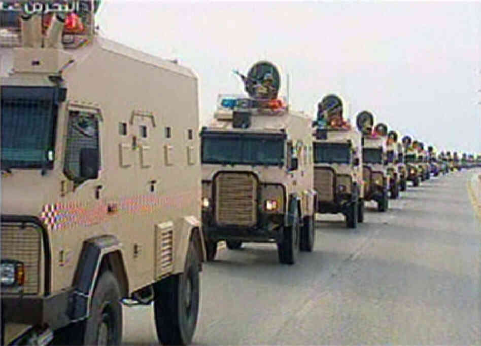 "An image grab taken from Bahrain TV shows ""vanguard"" of a contingent of Gulf troops arriving in the unrest-wracked Kingdom of Bahrain."
