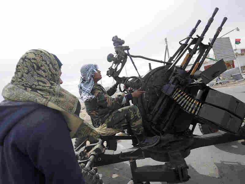 Libyan rebels man an anti-aircraft machine gun on March 13 in the town of Brega, before heavy shelling from forces loyal to Libyan leader Moammar Gadhafi.