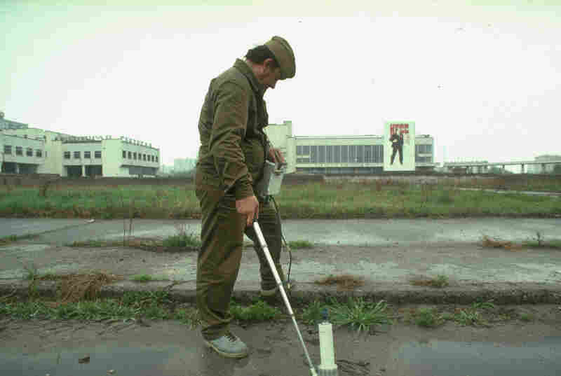 A worker measures ground radiation in a town abandoned after the catastrophic 1986 accident at the nearby Chernobyl nuclear power plant.