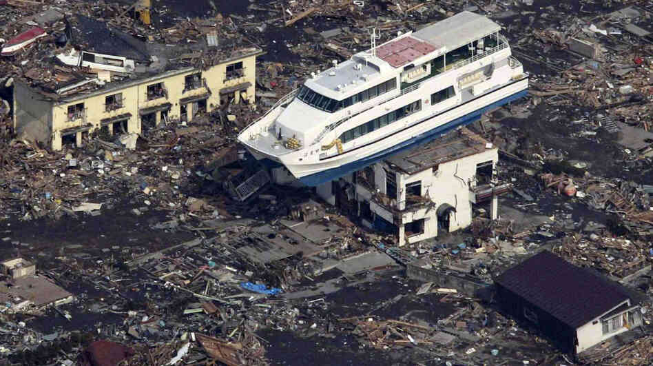 This aerial shot shows a pleasure boat sitting on top of a building amid a sea of debris in Otsuchi town in Iwate prefecture on March 14, following the March 11 tsunami.