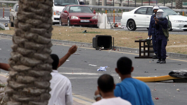 Riot police fire a tear gas canister at anti-government protesters Sunday, March 13, 2011, in Manama, Bahrain.