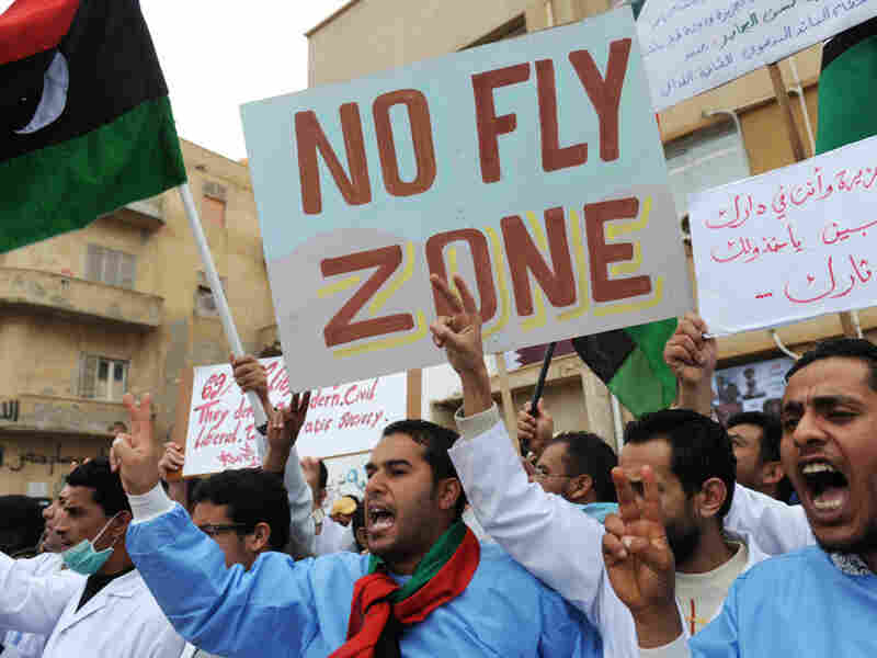 Doctors working at a local hospital join other protesters in calling for a no-fly zone over Libya at a rally in the eastern Libyan town of Benghazi on March 13.
