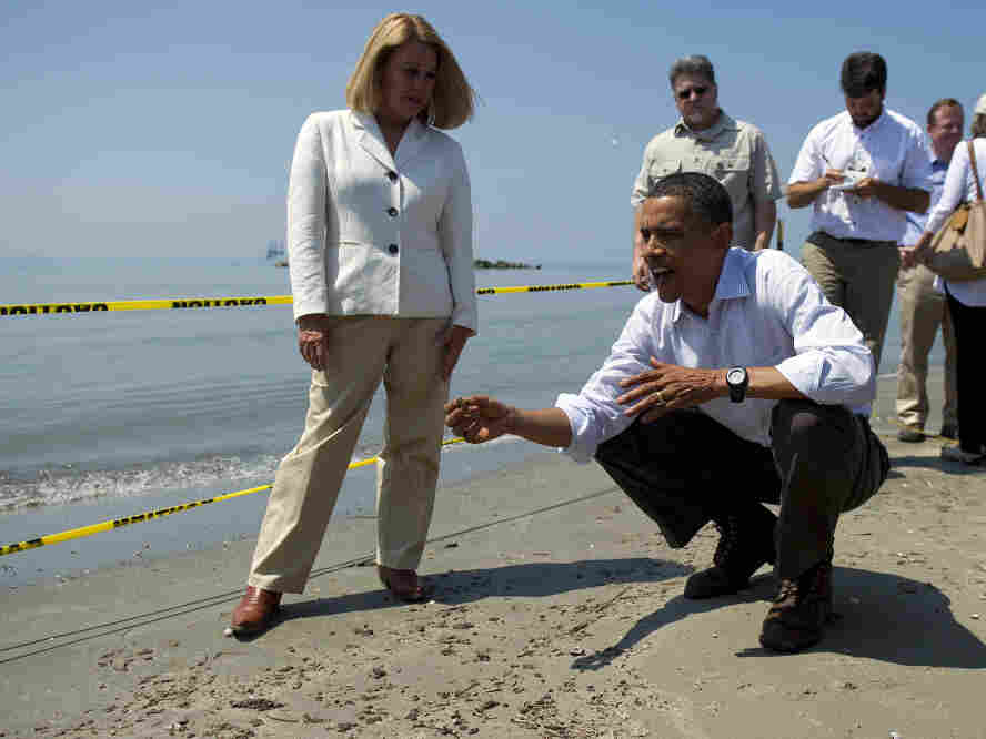 Disaster seems to haunt President Obama's energy initiatives. He holds a tar ball in May 2010 Port Fourchon Beach, LA.