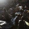 Japanese refugees rest inside a school gymnasium where hundreds took shelter in Sendai, northeastern Japan, Monday.