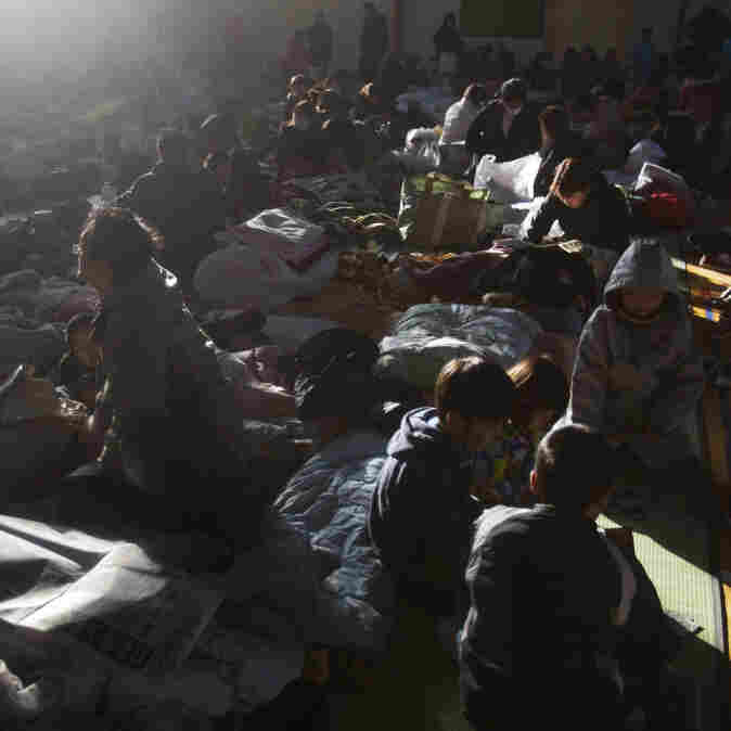 Japanese refugees rest inside a school gymnasium where hundreds took shelter in Sendai, northeastern Japan, Monday.