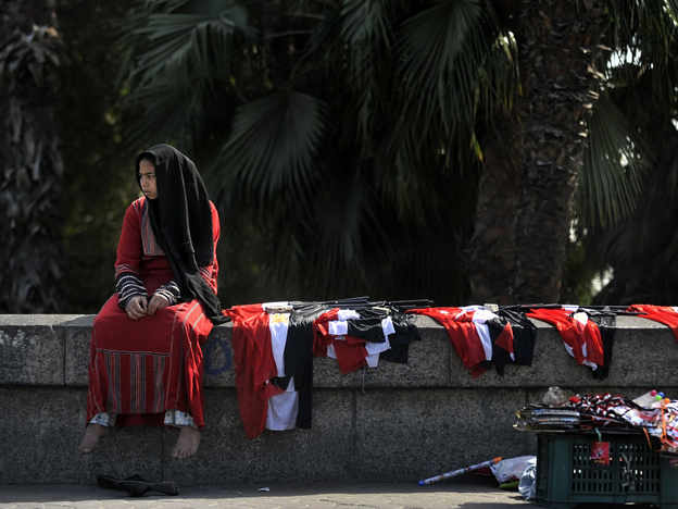 A young woman sells Egyptian flags in central Cairo on Monday. Voters are scheduled to go to the polls on Saturday for a referendum on proposed constitutional amendments.