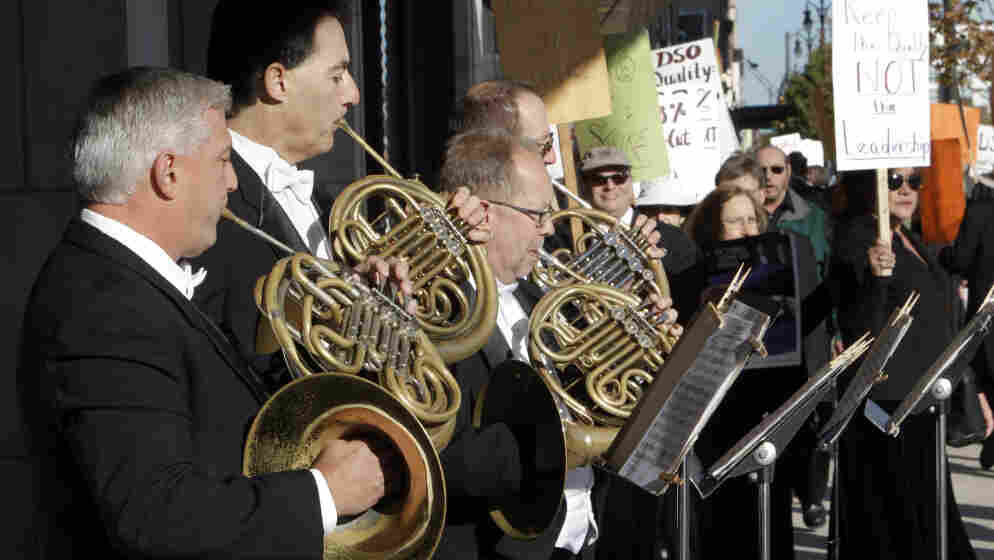 Members of the Detroit Symphony Orchestra play French horns while serenading their picketing colleagues outside the Max M. Fisher Music Center in Detroit, on Oct. 4, 2010. The musicians  called a strike after refusing to accept pay cuts of more than 30 percent demanded by the financially struggling Detroit Symphony Orchestra.
