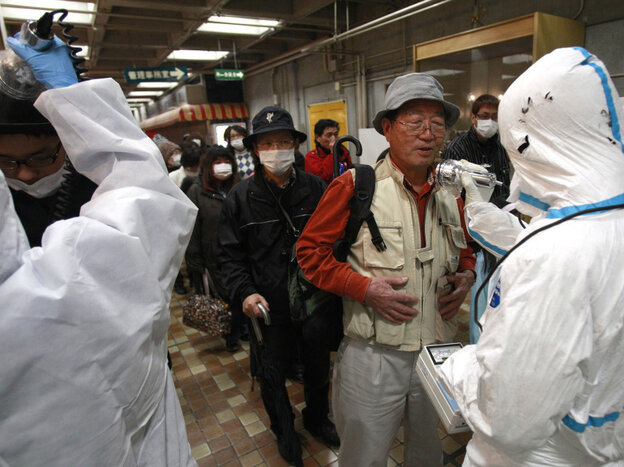 An evacuee is screened for radiation exposure at a testing center in Koriyama, Japan, after a nuclear power plant on the coast of the Fukushima prefecture was damaged by Friday's earthquake.