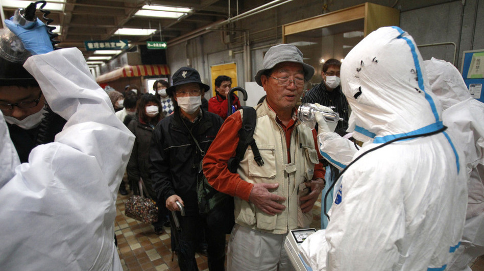 An evacuee is screened for radiation exposure at a testing center on Tuesday in Koriyama, Japan, after a nuclear power plant on the coast of the Fukushima prefecture was damaged by Friday's earthquake.