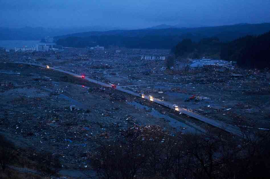 Cars drive through the ruins of the leveled city of Minamisanriku, northeastern Japan on Tuesday.