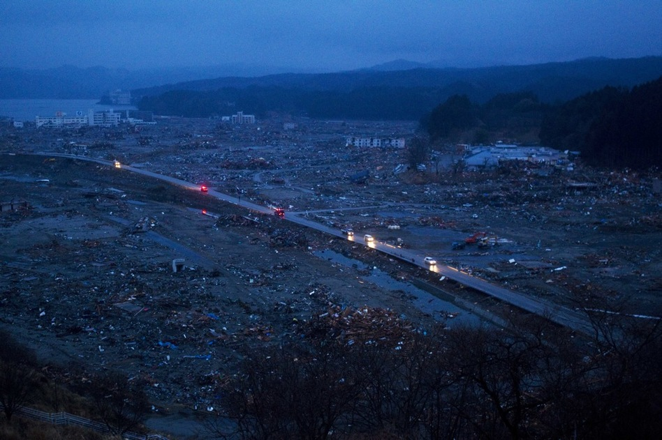 Cars drive through the ruins of the leveled city of Minamisanriku, northeastern Japan on Tuesday.  (AP)