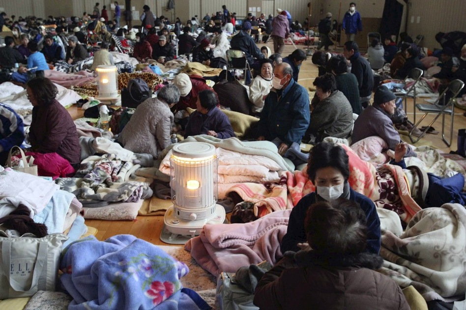 Evacuees rest at a shelter in Yamada, Iwate prefecture, in northern Japan on Tuesday.  (AP)