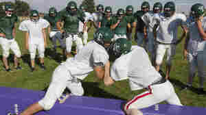 Players for the combined football team of Sandhills High School and Thedford High School train during practice in Dunning, Neb., in 2009.