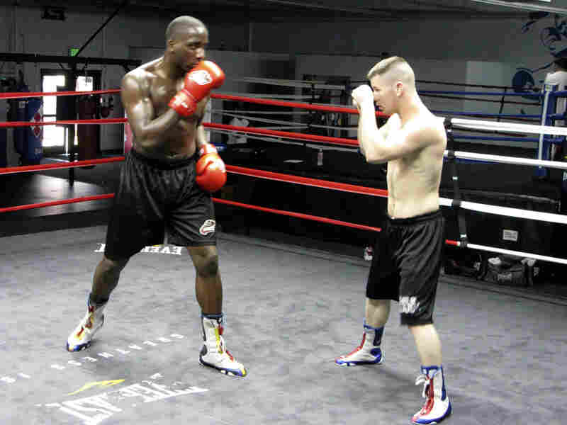 """David """"The Dream Catcher"""" Imoesiri, left, spars with Eric """"Fearless"""" Fowler during a training session at The Rock boxing gym."""