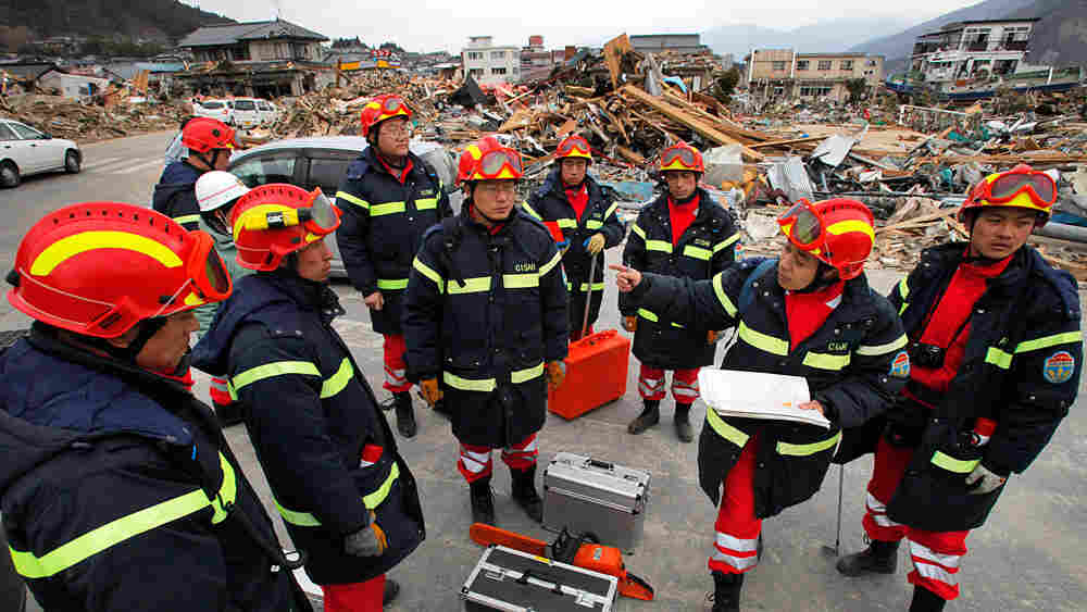 Members of the Chinese rescue team are briefed by their leader in Ofunato, Iwate prefecture, Japan, on Tuesday.