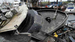 Half-sunken boats, docks and debris lie tangled in Crescent City, Calif., after a tsunami surged Friday in Northern California.