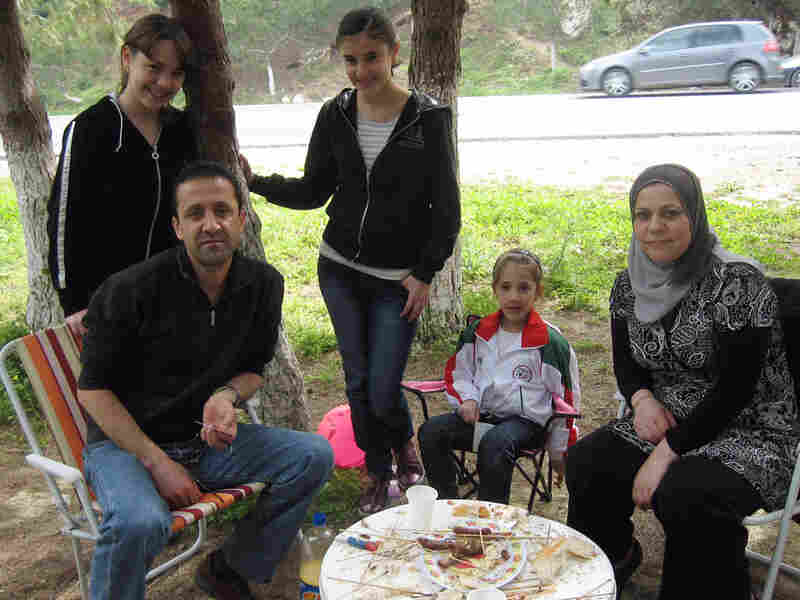 "The Chilla family, like many others from Algiers, travels outside the city on weekends. Here they picnic near the coast. Mourad Chilla says the situation in Algeria is different from that in Tunsia and Egypt. ""We have liberty,"" he says."