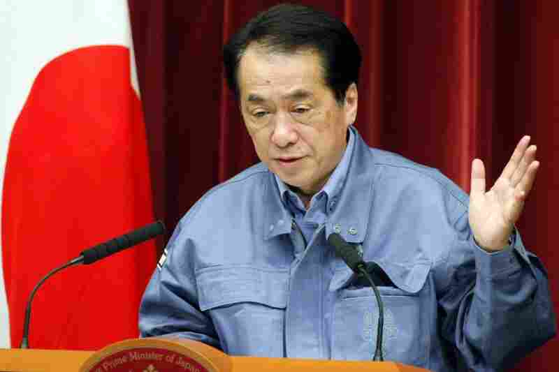 Japanese Prime Minister Naoto Kan told people living up to 12 miles outside an exclusion zone around a quake-hit nuclear plant to stay indoors, as a fire sent radiation to dangerous levels.