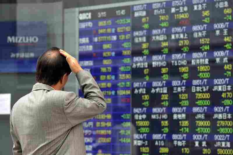 A stock price board in Tokyo reflects the market's plunge.
