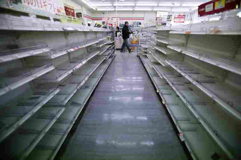 The shelves of a convenience store are empty in Ofunato, Iwate prefecture, northern Japan.