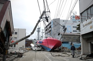 A boat lies in a street in Hishonomaki, Miyagi prefecture, washed inland by the recent tsunami.