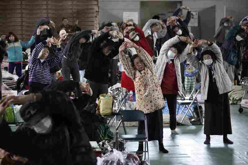 Evacuees exercise at a makeshift shelter in Minamisanriku, northern Japan.