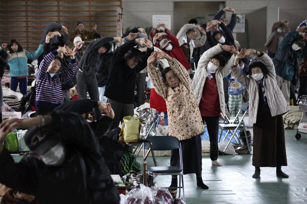Evacuees exercise at a makeshift shelter in Minamisanriku, northern Japan.