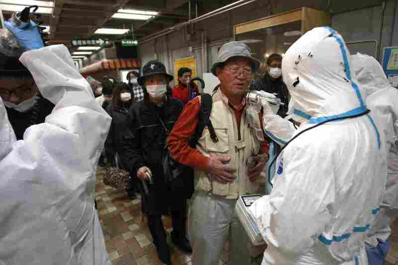 An evacuee is screened for radiation exposure at a testing center in Koriyama city, Fukushima prefecture.