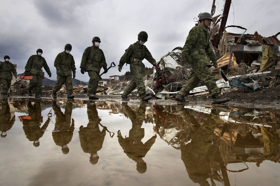 Japanese military march during a search and rescue mission scouring the rubble of a village in Rikuzentakata, Miyagi prefecture, Japan.  (Getty Images)
