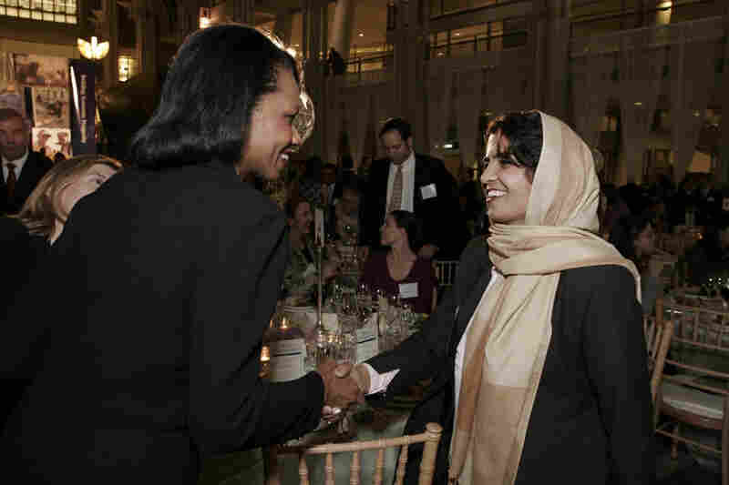 Kamila receiving congratulations from Condoleezza Rice. Courtesy US Global Leadership Campaign.