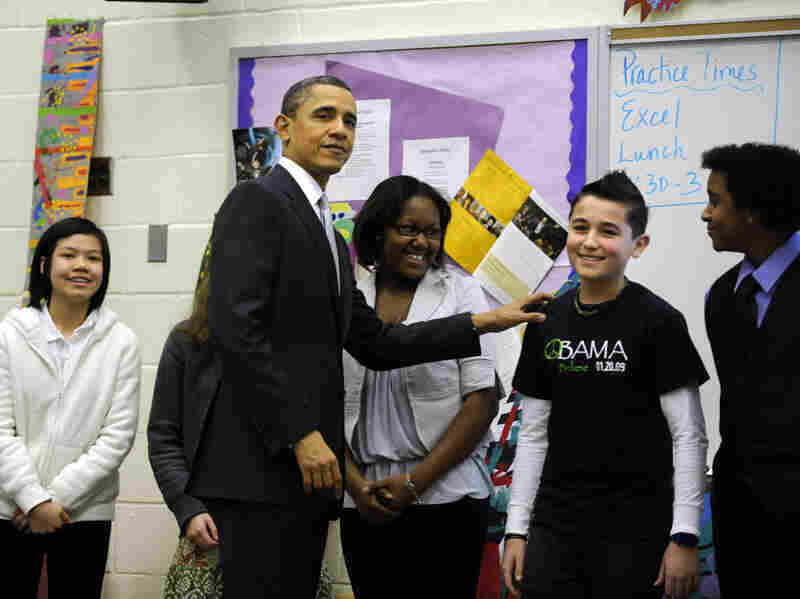 "U.S. President Barack Obama visits with students in a classroom while at Kenmore Middle School to deliver a speech on reforming education on Monday. President Obama called on the Congress ""to fix the No Child Left Behind before the start of the next school year."""
