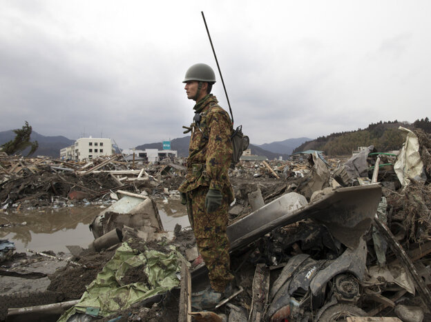 A Japanese soldier stood watch earlier today (March 15, 2011) ove