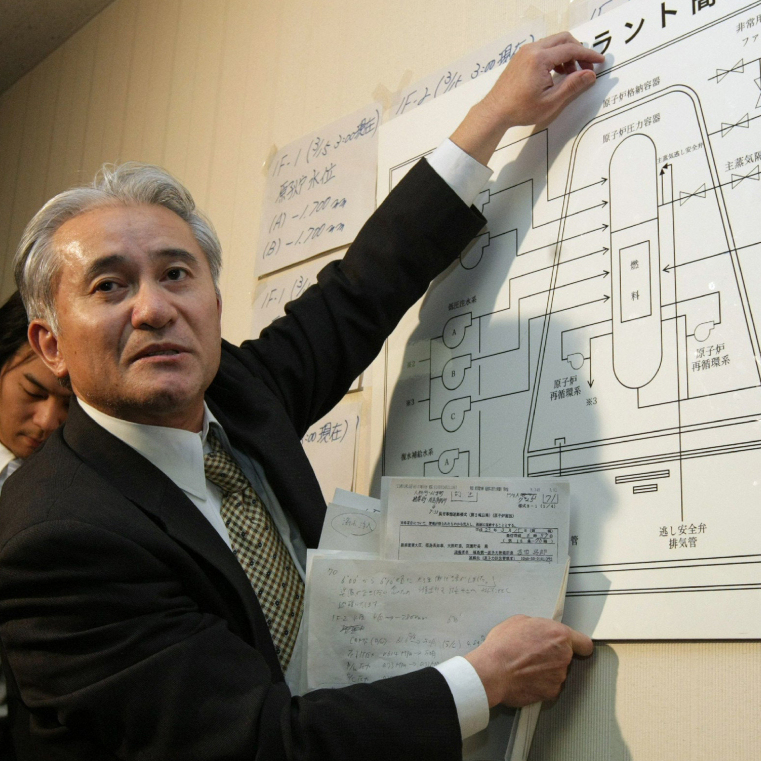 A nuclear plant specialist with the Tokyo Electric Power Co. explains the structure of a nuclear reactor at the company's Fukushima power plant during a news conference Tuesday.